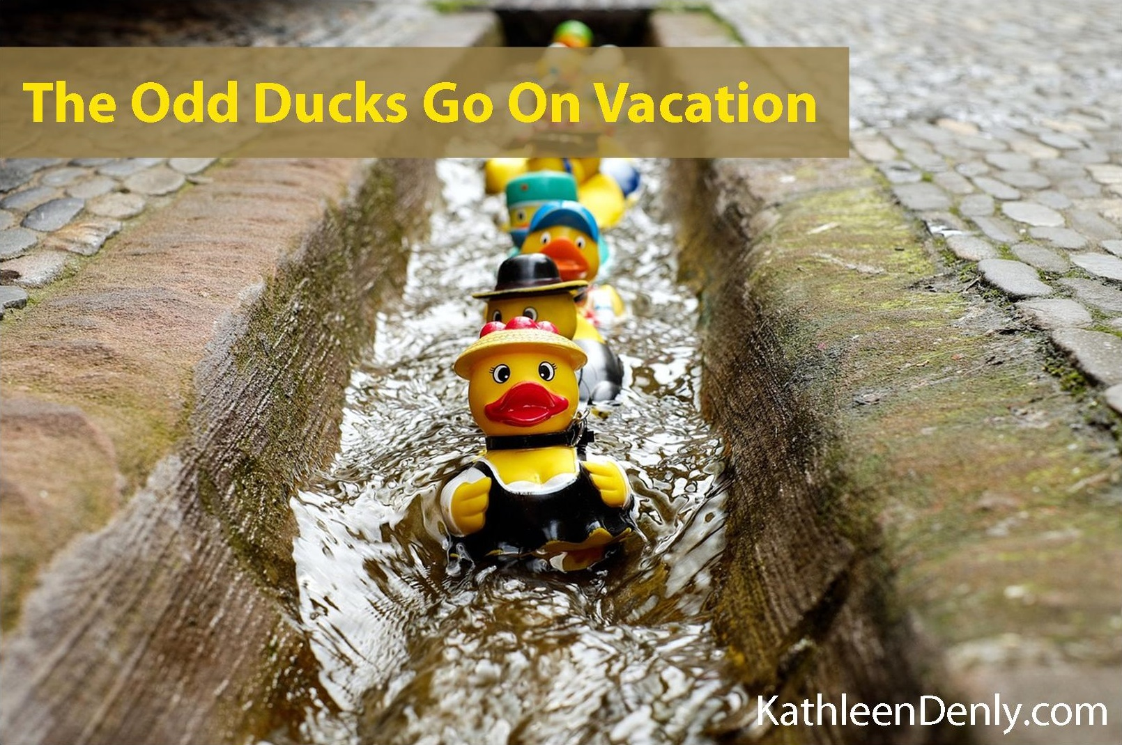 Title Image for The Odd Ducks Go On Vacation on Kathleen Denly.com . Shows various rubber duckies dressed in different outfits and floating in a line down an old drainage channel between cobblestone walkways.